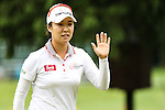 South Korean Haeji Kang waves to the crowd on the fifth hole during Round 2 of the LPGA Championship at Locust Hill Country Club in Pittsford, NY on June 8, 2013
