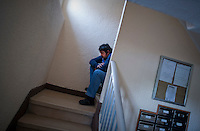 SPAIN, Madrid: Raul Moreno Mostajo, nephew of Vicente Torres, 73, is pictured in the staircase of Vicente's apartment in Madrid on April 18, 2012. Vicente Torres, who is severy ill and underwent a recent heart surgery, faces an eviction from his house. Eviction procedures in Spanish courts for unpaid mortgages and rent hit a record of 58,241 in 2011, a 21.2 percent rise over the previous year. Evictions have soared in Spain since the collapse of a property bubble in 2008 that triggered the country's economic crisis. (c) Pedro ARMESTRE