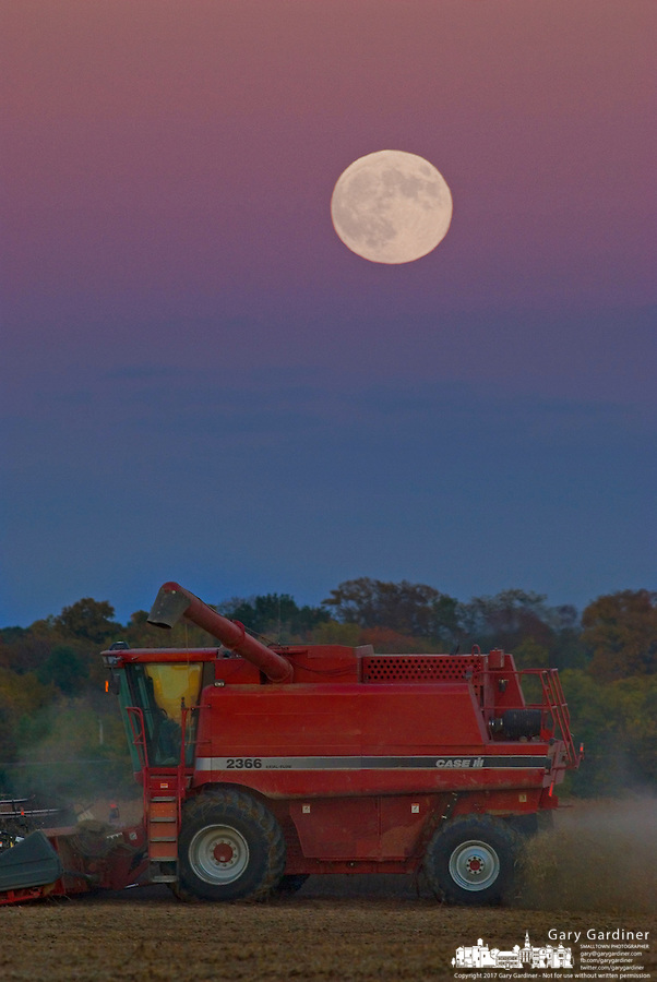 The full moon rises over a farmer harvesting soybeans near Jones, Ohio.<br />