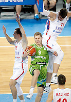 """Jaka Blazic of Slovenia (C) in action during European basketball championship """"Eurobasket 2013"""" classification basketball game from 5th to 8th place between Serbia and Slovenia in Stozice Arena in Ljubljana, Slovenia, on September 19. 2013. (credit: Pedja Milosavljevic  / thepedja@gmail.com / +381641260959)"""
