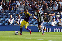 Sunday 01 September 2013<br /> Pictured L-R: Pablo Hernandez of Swansea is marked by Liam Ridgewell of West Brom, crosses the ball to team mate Ben Davies who scored the opening goal.<br /> Re: Barclay's Premier League, West Bromwich Albion v Swansea City FC at The Hawthorns, Birmingham, UK.