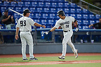 Anthony Seigler (20) of the Hudson Valley Renegades celebrates with third base coach Aaron Bossi (93) after hitting the first of two home runs on the night against tbe Wilmington Blue Rocks at Dutchess Stadium on July 27, 2021 in Wappingers Falls, New York. (Brian Westerholt/Four Seam Images)
