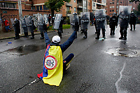 BOGOTA, COLOMBIA - MAY 01 : Colombian police officers take position to disperse people as they take part in a protest against Colombian government and the tax reform during the International Workers' Day on May 01, 2021 in Bogota, Colombia. Hundreds of Colombians protest against a tax bill reform plan for the fourth day in a row which aimed to raise some $ 6.3 billion in additional revenue over 10 years for Colombia, which saw GDP fall 6.8 percent in 2020 .(Photo by Leonardo Munoz/VIEWpress)