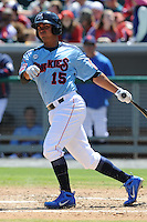 Tennessee Smokies third baseman Jonathan Mota #15 swings at a pitch during a game between the Jackson Generals and the Tennessee Smokies at Smokies Park, Kodak, Tennessee April 11, 2012. The Generals won 2-1  (Tony Farlow/Four Seam Images)..