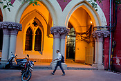 A pedestrian walks past the Calcutta High Court in the BBD Bagh area of Kolkata, India, on Thursday, May 25, 2017. Photographer: Sanjit Das