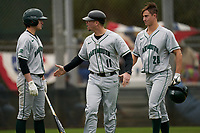 Dartmouth Big Green coach Conor Burke (11) with Justin Murray (5) and Kolton Freeman (28) during a game against the Indiana State Sycamores on February 21, 2020 at North Charlotte Regional Park in Port Charlotte, Florida.  Indiana State defeated Dartmouth 1-0.  (Mike Janes/Four Seam Images)