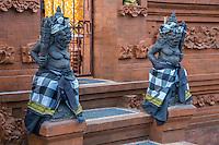 Jimbaran, Bali, Indonesia.  Hindu Temple Guardians Wearing Saput Poleng, the black and white cloth symbolizing the dual nature of the universe.
