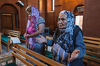 Armenia. Ararat Province. Byuravan. Armenian Apostolic Church. Eltwo elderly women pray during a morning mass at Saint Gregory the Illuminator church. The Armenian Apostolic Church is the national church of the Armenian people. Part of Oriental Orthodoxy, it is one of the most ancient Christian communities. Byuravan is a village located in the Ararat Province. 10.10.2019 © 2019 Didier Ruef