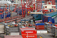 Cargo containers being off loaded in the port city of Vancouver, CA, Canada