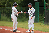 03 June 2010: Catcher Boris Marche of Rouen checks with Pascal Osmont during the 2010 Baseball European Cup match won  8-4 by C.B. Sant Boi over the Rouen Huskies, at the Kravi Hora ballpark, in Brno, Czech Republic.