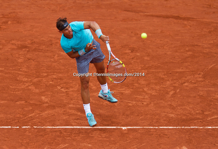 France, Paris, 26.05.2014. Tennis, Roland Garros, Rafael Nadal (ESP) is hitting a smash in his match against Robby Ginepri (USA)<br /> Photo:Tennisimages/Henk Koster