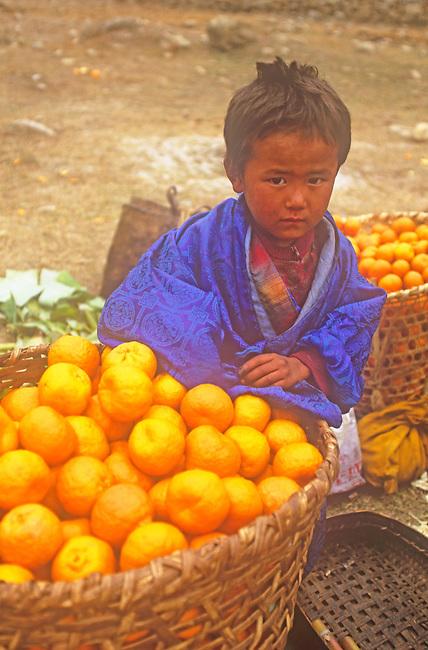 Boy with Oranges, Market, Punakha, Bhutan