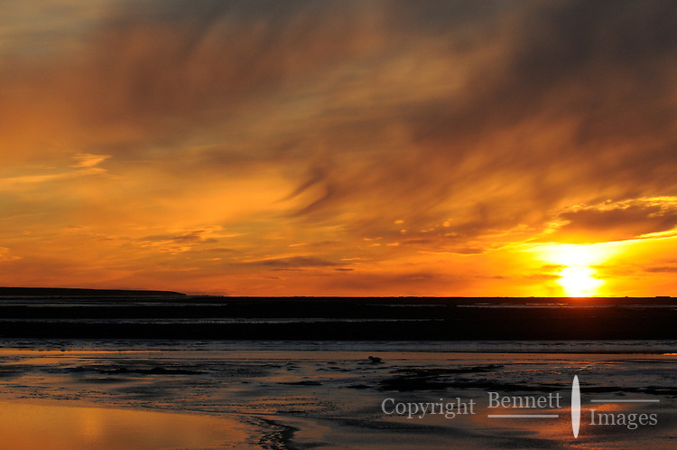 Sunset over a barrier island, just outside of Kaktovik. Every fall, polar bears gather near the community of Kaktovik, Alaska, on the northern edge of ANWR, waiting for the Arctic Ocean to freeze. The bears have become a symbol of global warming.