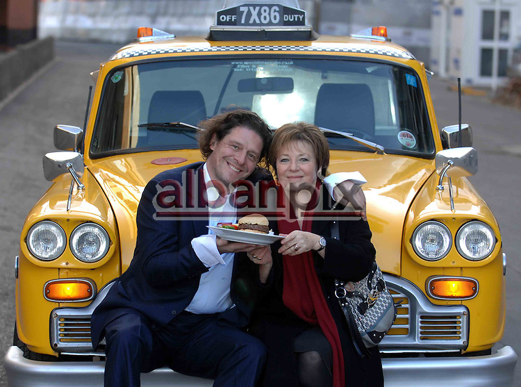 """Marco Pierre-White an Delia Smith arrive in an .American Taxi at the opening of Delia's American .Style diner """"Yellows"""" at Carrow Road in Norwich, Norfolk.."""
