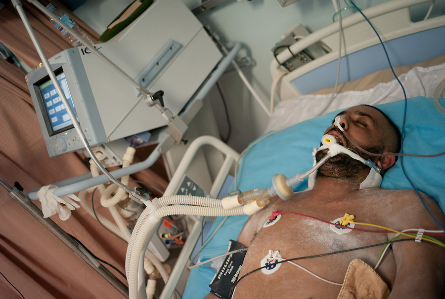 Rebel fighter hooked up to critical life-support machines in Benghazi, LIbya.