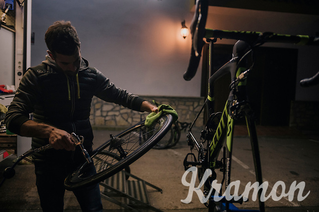 mechanics at work late into the night at the 2018 Michelton-Scott training camp in Almeria, Spain