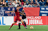 FOXBOROUGH, MA - SEPTEMBER 21: Sebastian Saucedo #23 of Real Salt Lake dribbles as Luis Caicedo #27 of New England Revolution defends during a game between Real Salt Lake and New England Revolution at Gillette Stadium on September 21, 2019 in Foxborough, Massachusetts.