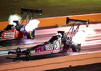 Oct 18, 2019; Ennis, TX, USA; NHRA top fuel driver Antron Brown (near) races alongside Shawn Reed during qualifying for the Fall Nationals at the Texas Motorplex. Mandatory Credit: Mark J. Rebilas-USA TODAY Sports