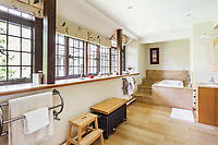 BNPS.co.uk (01202 558833)<br /> Pic: Hamptons/BNPS<br /> <br /> Pictured: A bathroom.<br /> <br /> An incredible Arts and Crafts country house with its own vineyard is on the market for offers over £7m.<br /> <br /> The Grade II listed St Joseph's Hall is a striking 111-year-old property that was home to the Bishop of Arundel for 40 years.<br /> <br /> It has a wealth of period features, an indoor swimming pool and seven acres of vineyard with mostly Chardonnay grapes, which the owners sell to a local winery.<br /> <br /> The house in Storrington, West Sussex, has 17 acres of land with beautiful views over the South Downs.