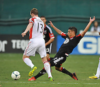 Luis Silva (12) of D.C. United goes against Steven Caldwell (130 of Toronto FC. Toronto FC tied D.C. United 1-1, at RFK Stadium, Saturday August 24 , 2013.