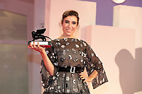 """VENICE, ITALY - SEPTEMBER 11: Blanca Li poses with the Best VR Experience Award for """"Le Bal De Paris De Blanca Li"""" at the awards winner photocall during the 78th Venice International Film Festival on September 11, 2021 in Venice, Italy."""