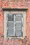 Rustic old shutters adorn an old building in Dubrovnik, Croatia.