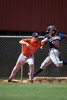 Houston Astros Kolbey Carpenter (59) stretches for a throw as Jeremy Fernandez (70) runs through the bag during an instructional league game against the Atlanta Braves on October 1, 2015 at the Osceola County Complex in Kissimmee, Florida.  (Mike Janes/Four Seam Images)