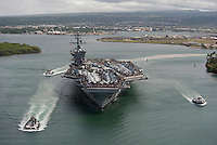 110610-N-DR144-050 PEARL HARBOR, HAWAII (June 10, 2011) The Nimitz-class aircraft carrier USS Carl Vinson (CVN 70) departs Pearl Harbor, Hawaii with Sailors' friends and families aboard for a Tiger Cruise.  Carl Vinson and Carrier Air Wing (CVW) 17 recently completed a deployment the U.S. 5th Fleet and U.S. 7th Fleet areas of responsibility. (U.S. Navy photo by Mass Communication Specialist 2nd Class James R. Evans / RELEASED)