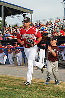 "Batavia Muckdogs third baseman J.J. Gould (49) takes the field with a young ""Stars of the Game"" participant before a game against the Brooklyn Cyclones on July 4, 2016 at Dwyer Stadium in Batavia, New York.  Brooklyn defeated Batavia 5-1.  (Mike Janes/Four Seam Images)"