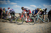 Zdenek Stybar (CZE/Etixx-QuickStep), Greg Van Avermaet (BEL/BMC) & Sep Vanmarcke (BEL/LottoNL-Jumbo) cornering through sector 6B: Bourghelles à Wannehain<br /> <br /> 113th Paris-Roubaix 2015