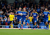 4th September 2021; Merton, London, England;  EFL Championship football, AFC Wimbledon versus Oxford City: Jack Rudoni of AFC Wimbledon holds the match ball after scoring his sides 1st goal in the 55th minute to make it 1-1