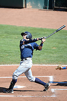 Dustin Houle (9) of the Helena Brewers follows through on his swing against the Ogden Raptors at Lindquist Field on July 21, 2013 in Ogden Utah. (Stephen Smith/Four Seam Images)
