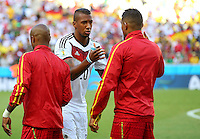 Jerome Boateng of Germany shakes hands with his brother Kevin Prince Boateng of Ghana before kick off