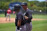 New York Yankees coach Tyson Blaser jokes with Jasson Dominguez (25) during an Extended Spring Training game against the Philadelphia Phillies on June 22, 2021 at the Carpenter Complex in Clearwater, Florida.  (Mike Janes/Four Seam Images)