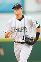 Charlotte Knights center fielder Trayce Thompson (17) jogs off the field between innings of the International League game against the Syracuse Chiefs at Knights Stadium on August 29, 2012 in Fort Mill, South Carolina.  (Brian Westerholt/Four Seam Images)