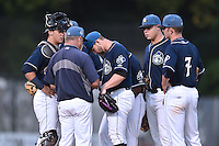 Asheville Tourists starting pitcher Tyler Chatwood (10), catcher Dom Nunez (9), pitching coach Mark Brewer (8), second baseman Forrest Wall (7) and first baseman Roberto Ramos (27) have a discussion during game 3 of the South Atlantic League Championship Series between the Asheville Tourists and the Hickory Crawdads on September 17, 2015 in Asheville, North Carolina. The Crawdads defeated the Tourists 5-1 to win the championship. (Tony Farlow/Four Seam Images)