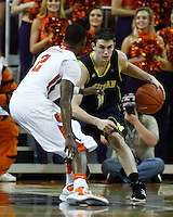Nov 30, 2010; Clemson, SC, USA; Michigan Wolverines guard Stu Douglas (1) dribbles the ball around Clemson guard Demontez Stitt (2) in the game against the Clemson Tigers at Littlejohn Coliseum. Mandatory Credit: Daniel Shirey/WM Photo -US PRESSWIRE