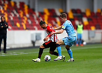 17th October 2020; Brentford Community Stadium, London, England; English Football League Championship Football, Brentford FC versus Coventry City; Ben Sheaf of Coventry City challenges Emiliano Marcondes of Brentford