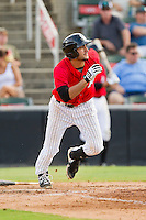Nick Basto (27) of the Kannapolis Intimidators hustles down the first base line against the Greensboro Grasshoppers at CMC-Northeast Stadium on July 13, 2013 in Kannapolis, North Carolina.  The Intimidators defeated the Grasshoppers 7-5.   (Brian Westerholt/Four Seam Images)