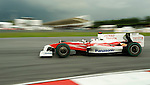 05 Apr 2009, Kuala Lumpur, Malaysia --- Panasonic Toyota Racing driver Jarno Trulli of Italy steers his car during the 2009 Fia Formula One Malasyan Grand Prix at the Sepang circuit near Kuala Lumpur. Photo by Victor Fraile --- Image by © Victor Fraile / The Power of Sport Images