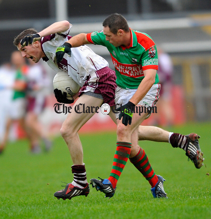 Liscannor's Thomas Murphy is tackled by Kilmurry Ibrickane's Brendan Moloney during the Senior football county final in Ennis. Photograph by John Kelly.