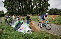 """Mathieu van der Poel (NED/Alpecin-Fenix) passing an """"accident de parcours""""<br /> <br /> Antwerp Port Epic / Sels Trophy 2021 (BEL)<br /> One day race from Antwerp to Antwerp (183km)<br /> <br /> The APC stands qualified as a 'road race', but with 36km of gravel and 28km of cobbled sections in and around the Port of Antwerp (BEL) this race occupies a unique spot in the Belgian race scene.<br /> <br /> ©kramon"""
