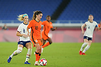 YOKOHAMA, JAPAN - JULY 30: Danielle van de Donk #10 of the Netherlands passes the ball during a game between Netherlands and USWNT at International Stadium Yokohama on July 30, 2021 in Yokohama, Japan.