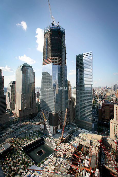 Tenth anniversary of 9/11.  Rebuilding at the World Trade Center site.  L to R: World Financial Center buildings, under-construction 1 WTC, 7 WTC.  The North Tower footprint, part of the 9/11 Memorial is under construction in front of 1 WTC. Photo by Ari Mintz.  8/11/2011.