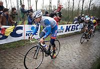 Bjorn Leukemans (BEL) (with Tom Boonen behind him) over the cobbles of the Molenberg<br /> <br /> Omloop Het Nieuwsblad 2014