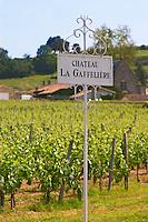 A white sign in the vineyard saying Chateau La Gaffeliere Saint Emilion Bordeaux Gironde Aquitaine France