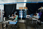 Jewelmer Pearlfarm, workstations for inserting nuclei into a pearl oyster.