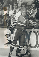 1987 FILE PHOTO - ARCHIVES -<br /> <br /> Stars have a board meeting. NHL star Claude Lemieux of the Montreal Canadiens is slammed into the boards by Soviet star Mikhail Tatarinov during early action at Quebec Colisee. Lemieux played his usal aggressive style and helped the NHL stars secure a 4-3 victory.<br /> <br /> PHOTO :  Jeff Goode - Toronto Star Archives - AQP