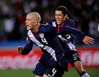 Michael Bradley of USA celebrates his goal with Herculez Gomez, 2-2