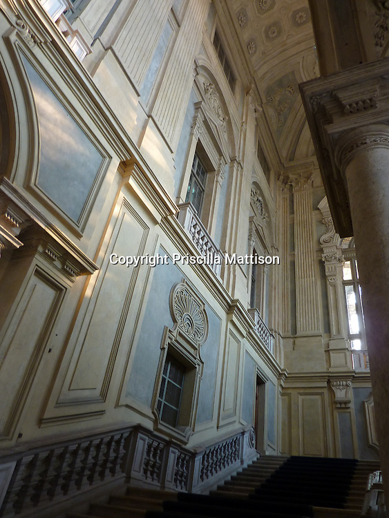 Turin, Italy - February 3, 2012:  Winter sun shines on the lower section of staircase at the Palazzo Madama.